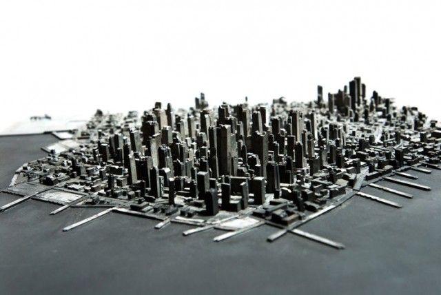 by Hong Seon Jang | com peças de tipos móveis de uma gráfica para criar uma paisagem elaborada | http://www.thisiscolossal.com/2012/05/a-miniature-city-built-with-metal-typography/