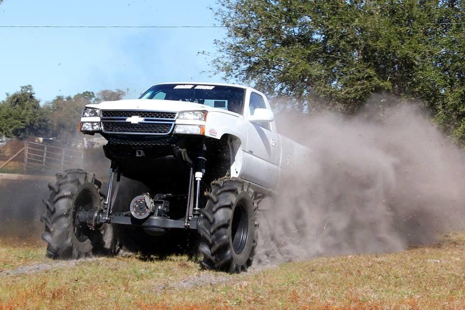 jacked up chevy trucks mudding - photo #9