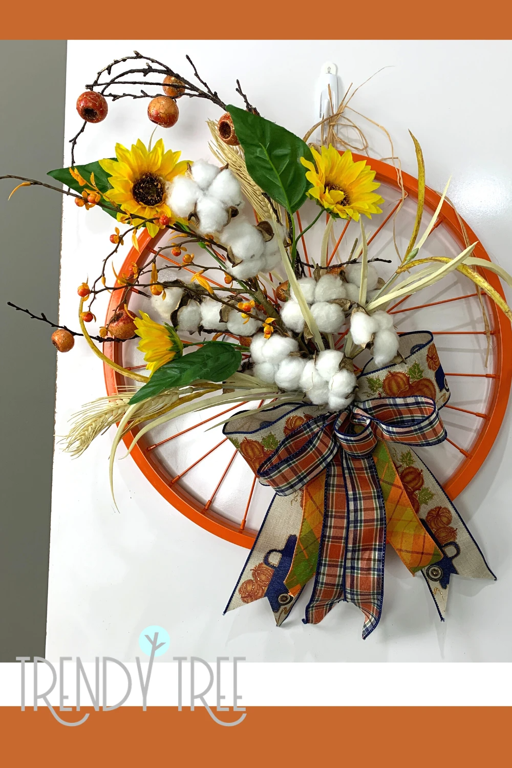 Fall Bicycle Wheel Wreath — Trendy Tree Visit the Trendy Tree blog to see the video tutorial.