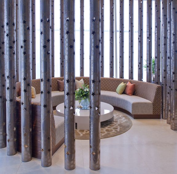 Perforated columns encircling lounge one