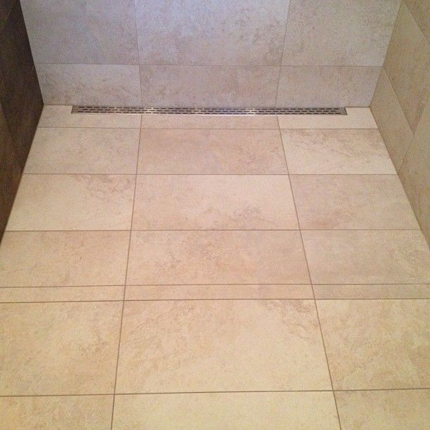 Tampa Fl Curb Less 12x24 Tile Shower Installation With Hydroban Waterproofing And A Laticrete 48 Linear Shower Installation Bathroom Remodel Master Tile Work
