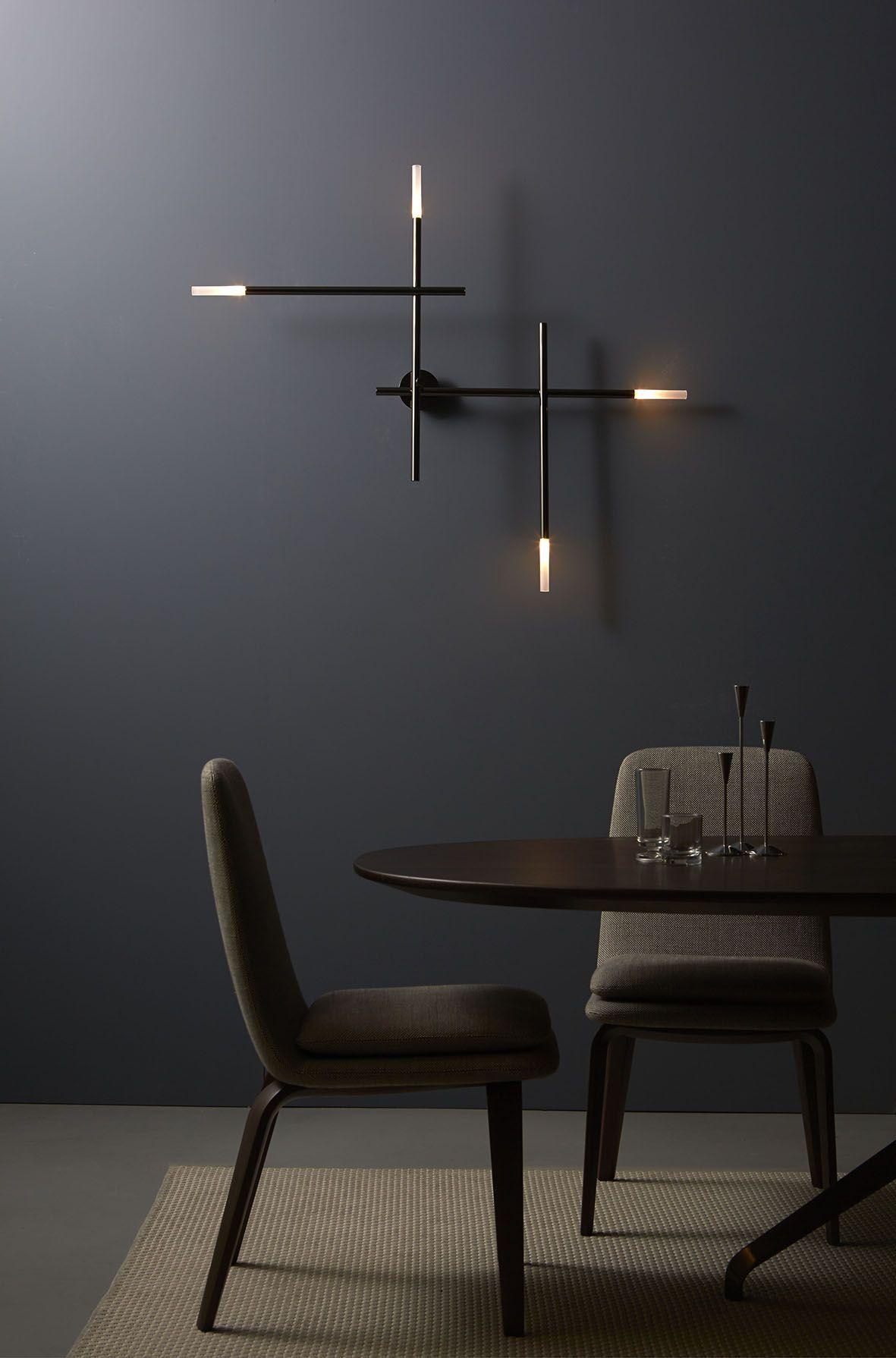 Lampada a muro, design minimale. Wall lamp, simple design. Lampada on grey walls with fireplace, grey walls with design, grey walls with wood furniture, grey walls with art ideas,