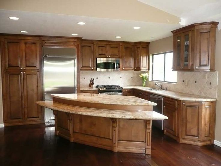 Different Woods Dark Hardwood Floors With Hickory Stained Cabinets And A Light Kitchen
