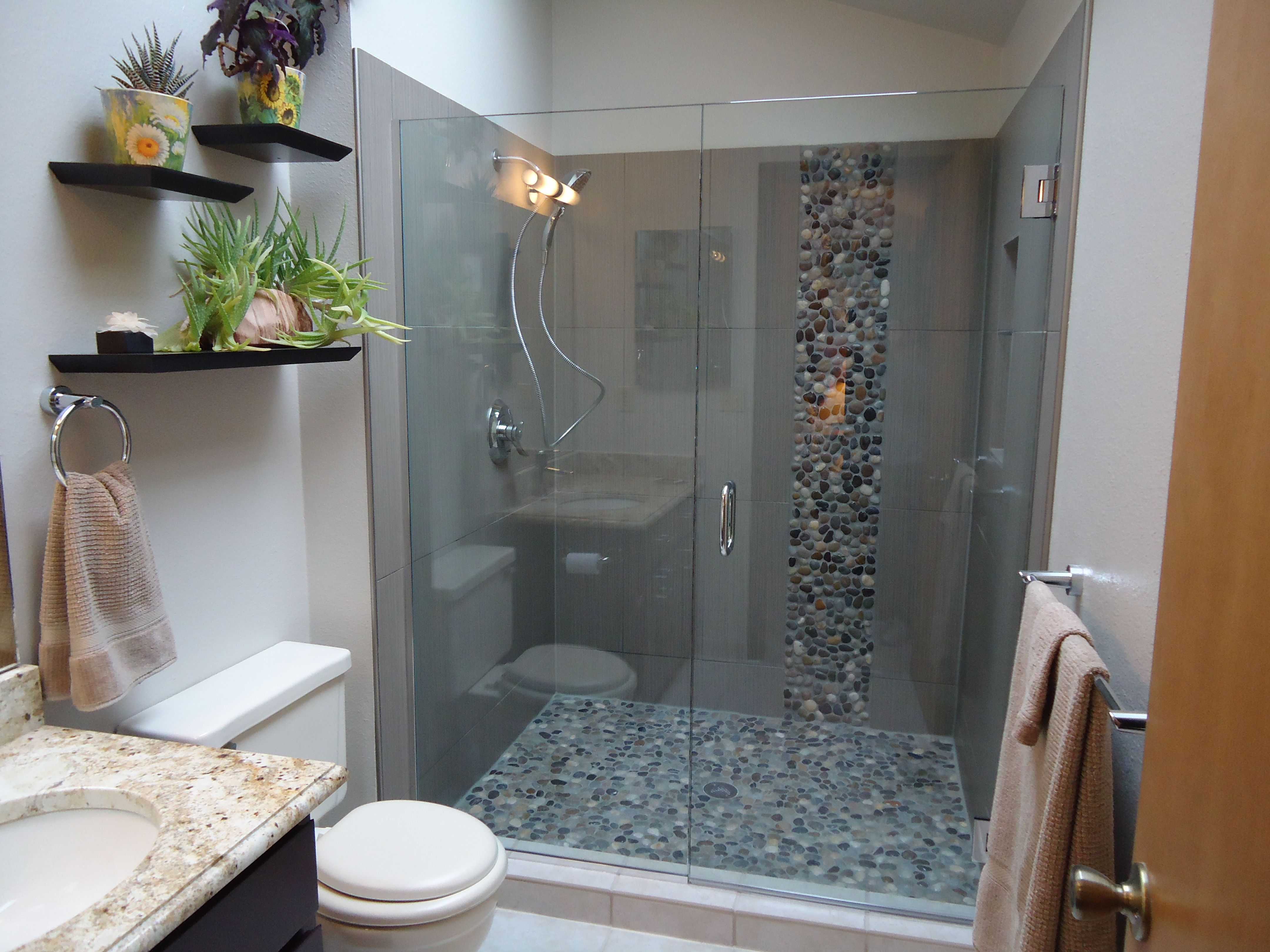 Large shower with large rectangle tile and pebble accent - Small bathroom ideas with shower only ...