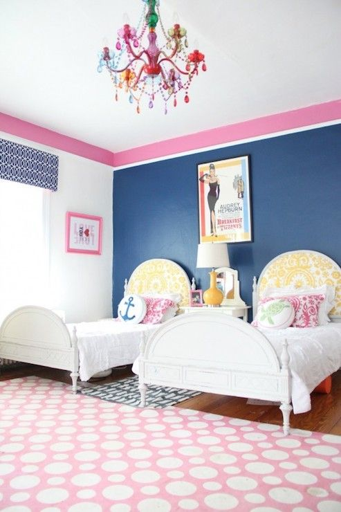 Fantastic Pink And Blue Twin Girlsu0027 Bedroom With Blue Accent Wall Alongside  White Window Wall United By A Pink Striped Border.