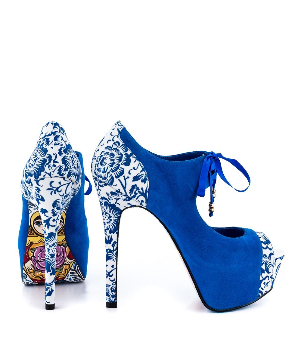 Nothing compares to the Nesta High Heels by TaylorSays. This fun style shoe features a bright blue fabric with beautiful floral trim. Underneath, a nesting doll is pictured on the sole with whimsical detailing. Creating a lift is 5 1/4 inch heel and 1 1/2 inch platform shoes.