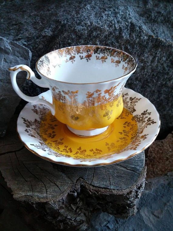 This immaculate Royal Albert Regal Series teacup and saucer set has elegant gold gift filigree design over bright sun yellow. The high handle design gives it royal sophistication. With tea being back in vogue for any age especially the millennials this would be a great gift for anyone and