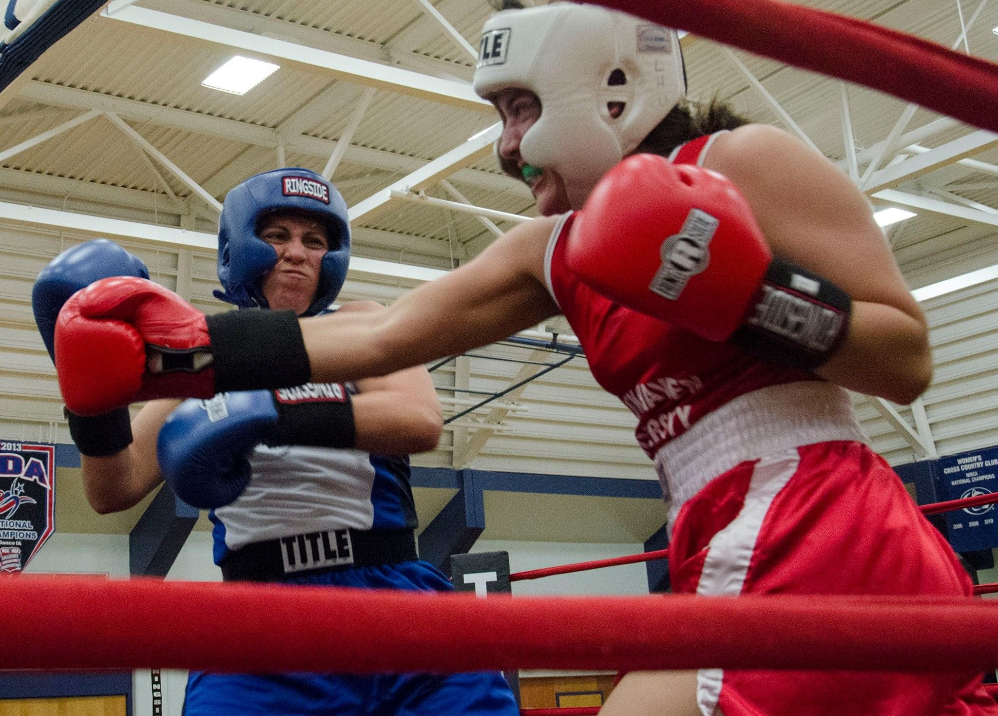 2/7/15 – Penn State's Jodie Villegas, left, moved her record to 3-0 after a win Saturday against Lock Haven's Mikayla Myers in a 139-pound bout in the White Building. Penn State Boxing hosted teams from several universities  for Fight Night at the White Building, a full card of afternoon and evening matches.