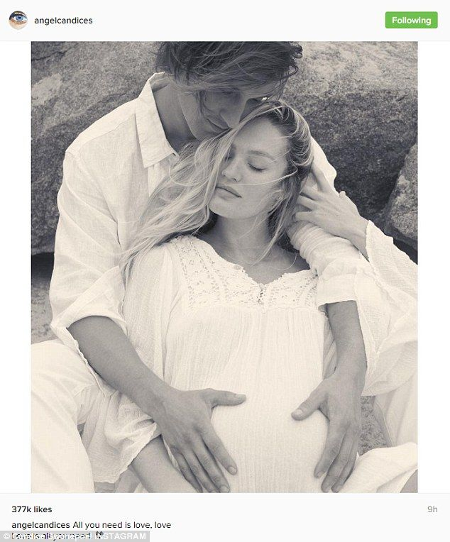 Pregnant Candice Swanepoel cuddles up with beau Hermann ...