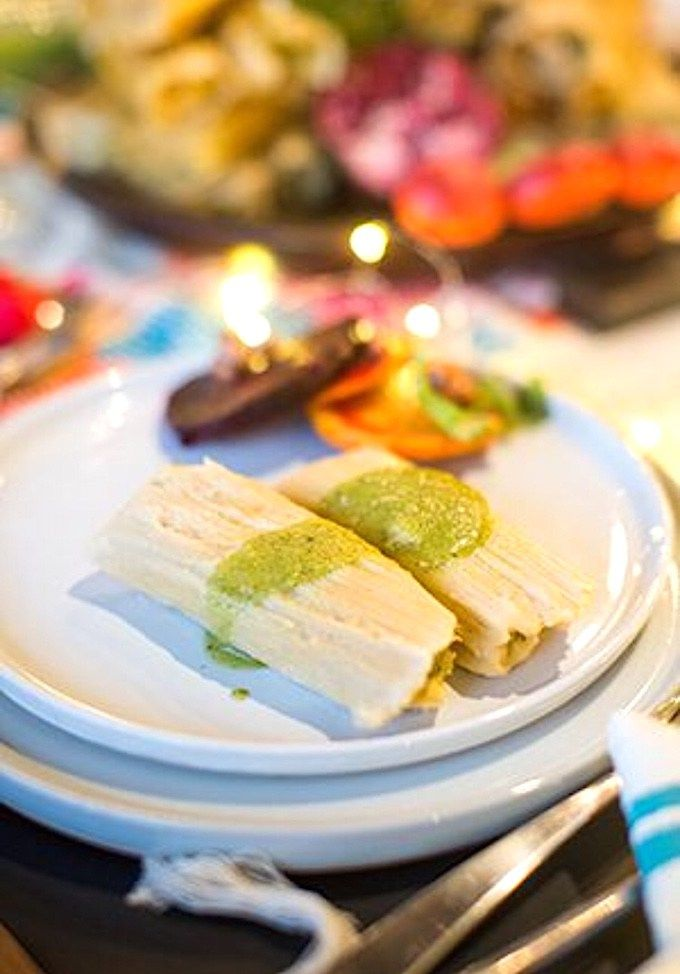These Chile Verde Chicken Tamales are like fluffy masa present waiting to be unwrapped;   stuffed with tender poached chicken and mild green tomatillo salsa.