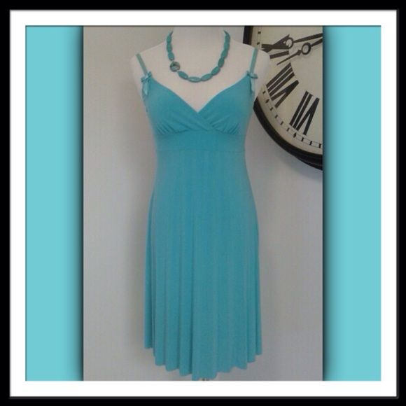 """Sweet Tiffany Blue Sweet, little sundress in that fabulous shade of Tiffany blue that we all love! 100% polyester is an effortless fabric.  Lovely accordian pleated skirt falls from an empire waist.  Sweetheart bra style bodice with stretchy sateen, adjustable straps.  Sweet bows adorned the straps.  Size Small fits true to size.  Worn a handful of times.  No defects, excellent condition. Lovely little frock. Measures: armpit to armpit 15"""" 