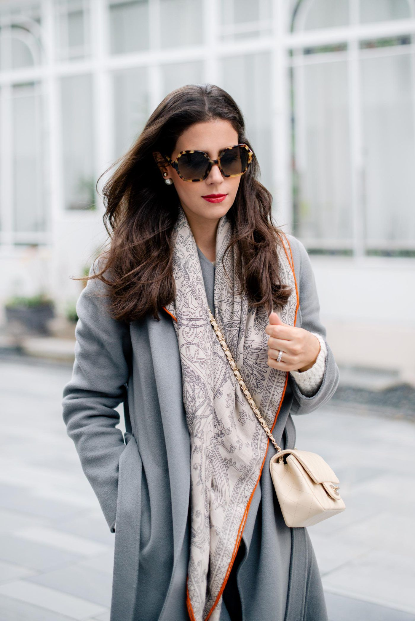 2f4f0760d045ce A blue coat with soft patterned silk scarf and cream bag Beige Chanel Bag,  Chanel