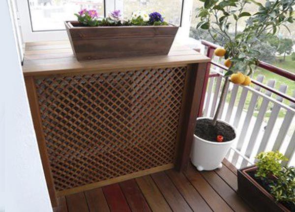 ocultar aire con mueble de madera exterior