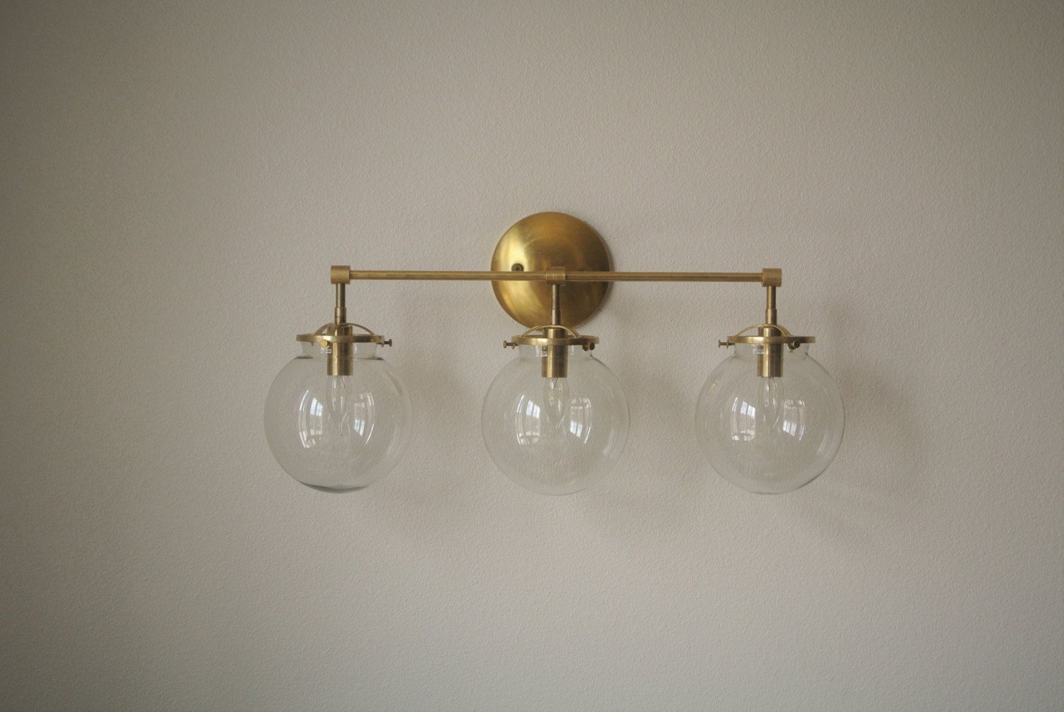 Bistro Globe Bath Sconce 4 Light: Triple Glass Globe Brass Wall Sconce Bathroom By