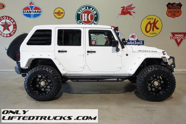 Lifted White 2016 Jeep Wrangler Unlimited Rubicon Fastback Kevlar Coated Jeep Wrangler Unlimited 2016 Jeep Wrangler Jeep Wrangler Unlimited Rubicon