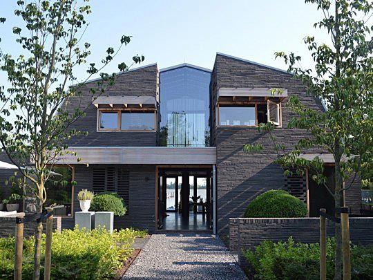 Villa rondom vide jvdh terras gevel huizen en