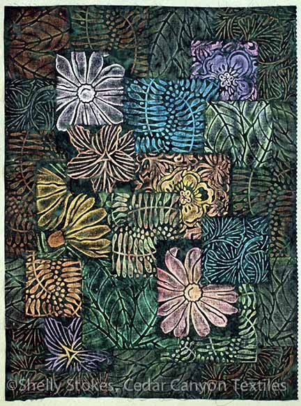 My garden collage quilt by Shelly Stokes  I painted a whole cloth collage on a dark green batik. To make the collage, I used rubbing plates and then proceeded to add stitching to each of the collage panels.