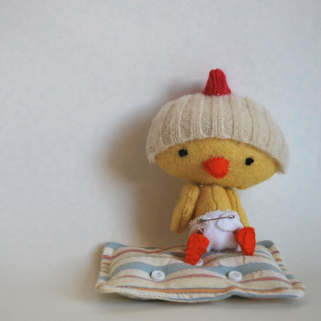 Bitty Birdie2 on cushion in hat