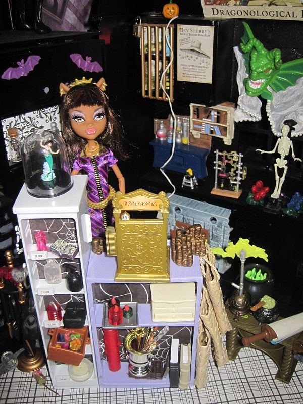 Monster High witch shop (idea for the monster high doll house I'm making). Love it. Might have to do something similar. I have tons of labels. For the little bottles. The blonde in the pic.