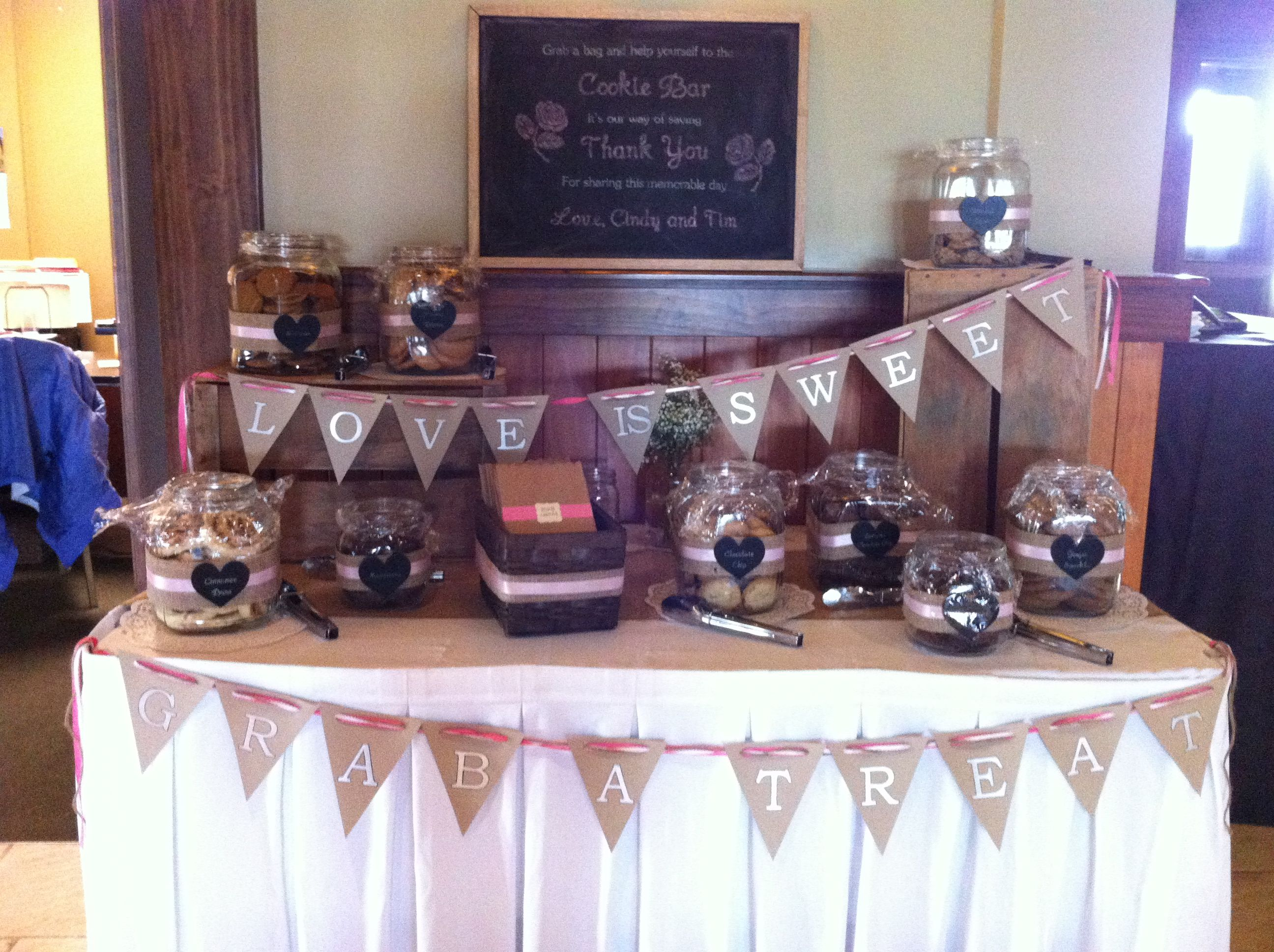 Cookie bar set up for guests at a reception.