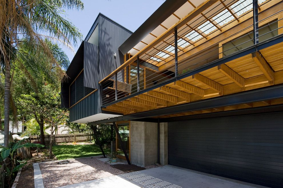 awesome deck over garage plans. Black Garage Door Under A Shady Wooden Balcony With Concrete Pavement Aside  The Green Yard Modern House In Middle Of Dense Vegetation in Sydney Pin by Grant Sorensen on Residential Architecture Landscape