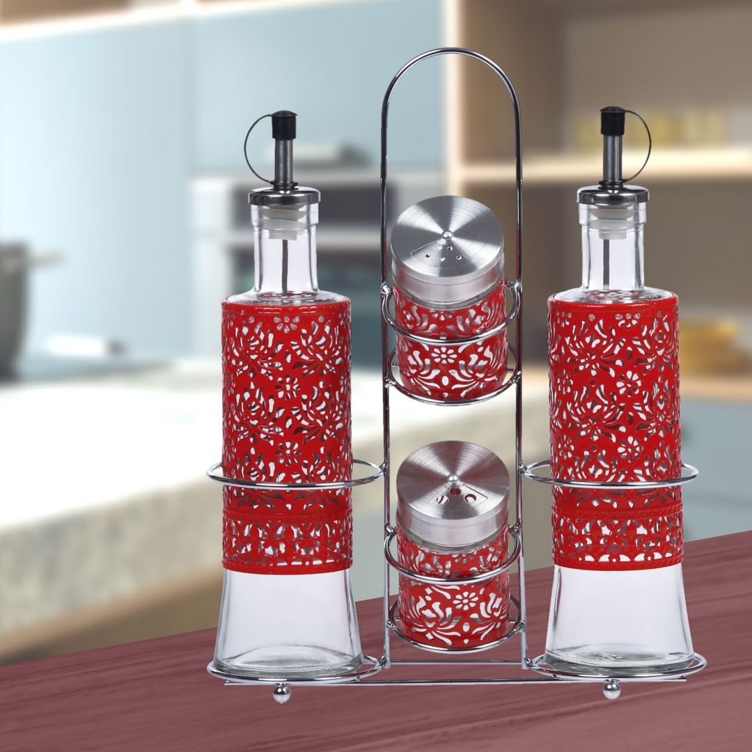 This beautiful painted metal and glass condiment set will keep your