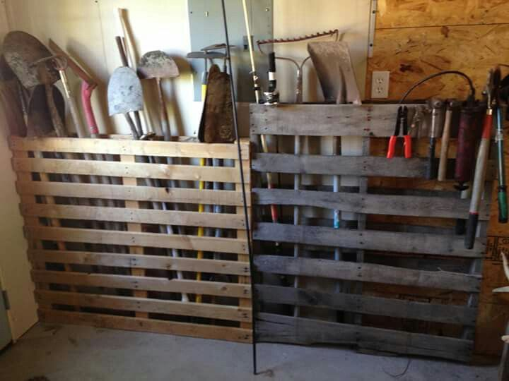 Use Pallets To Organize Garden Tools In The Garage