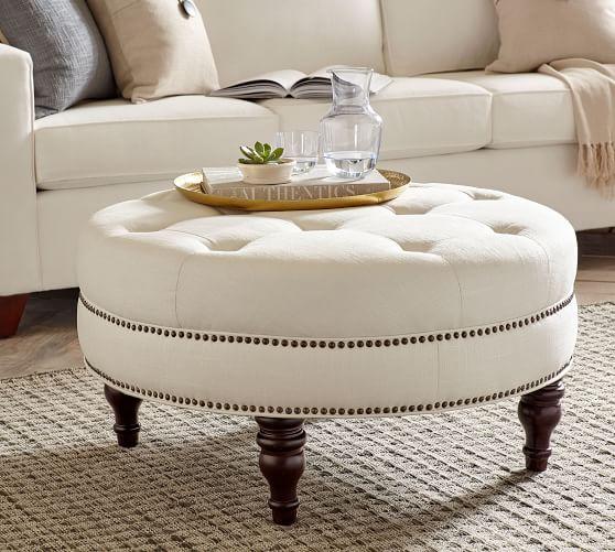 martin upholstered round ottoman linen