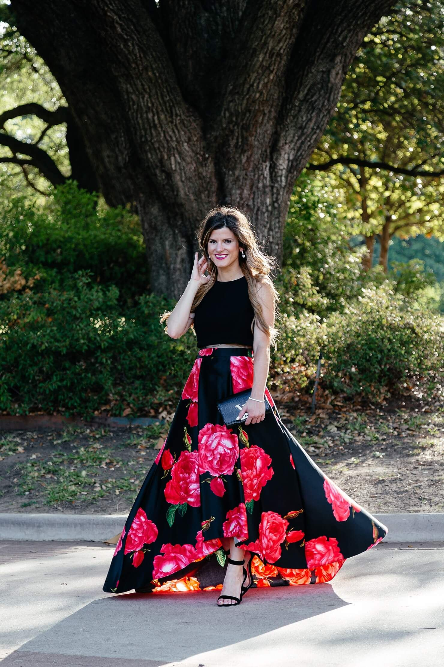 ab7abf5517 Black rose print asymmetrical maxi dress+black ankle strap heeled sandals+ black clutch+earrings. Summer Black Tie Wedding Guest Outfit 2017