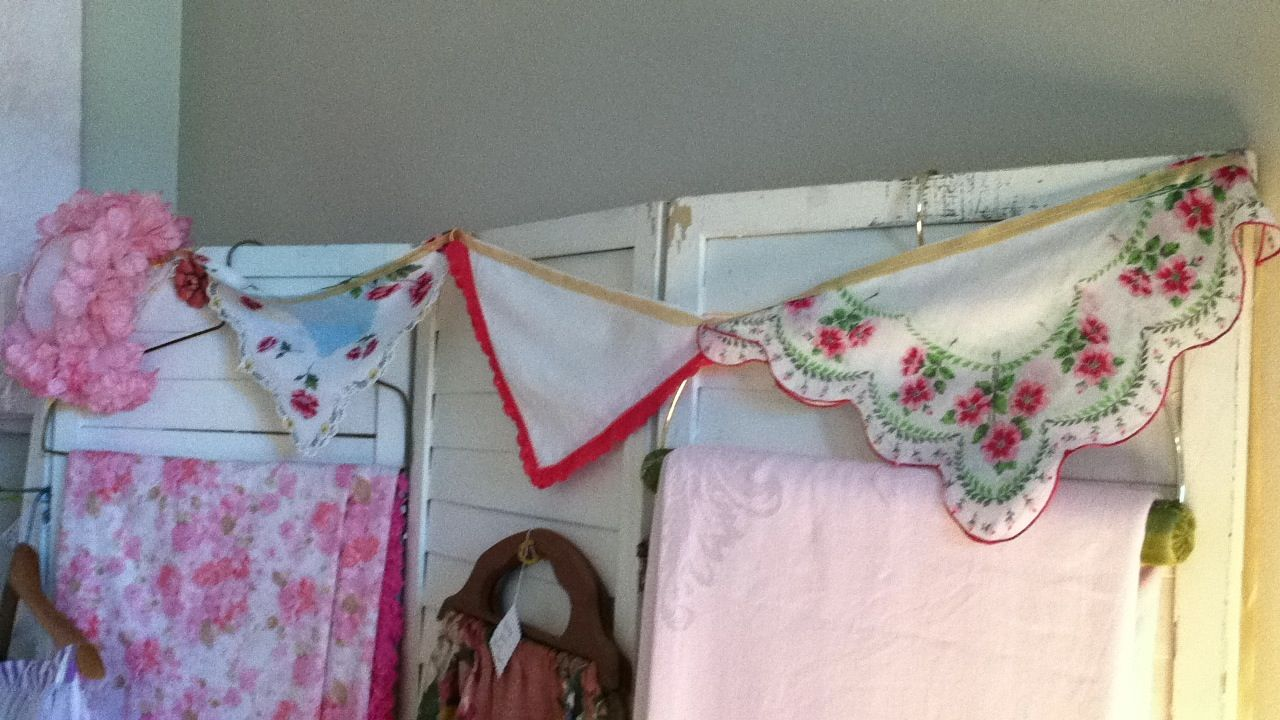 Saw this at a little shop by my house. Cute garland made of vintage hankies sewed in half over a ribbon. Cute! -mh