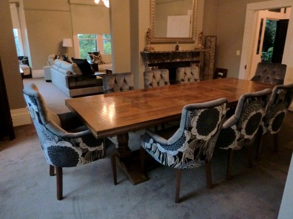 parquetry dining table with custom upholstered dining chairs