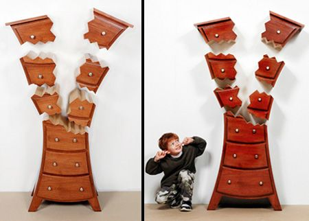 Dresser with wall mounted drawers that create explosive illusion. Dresser with wall mounted drawers that create explosive illusion