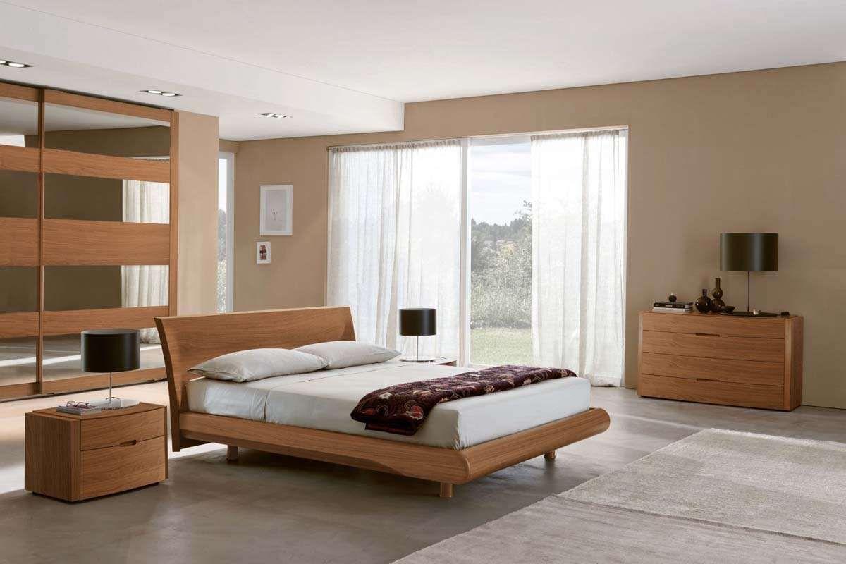 mobili color ciliegio e pareti sabbia | Camera da letto ...
