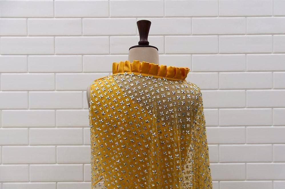 50dbeb19a1 ABRIANA : Spicy Mustard Kundan Drape sleeveless Top with box pleated collar  and Lehenga