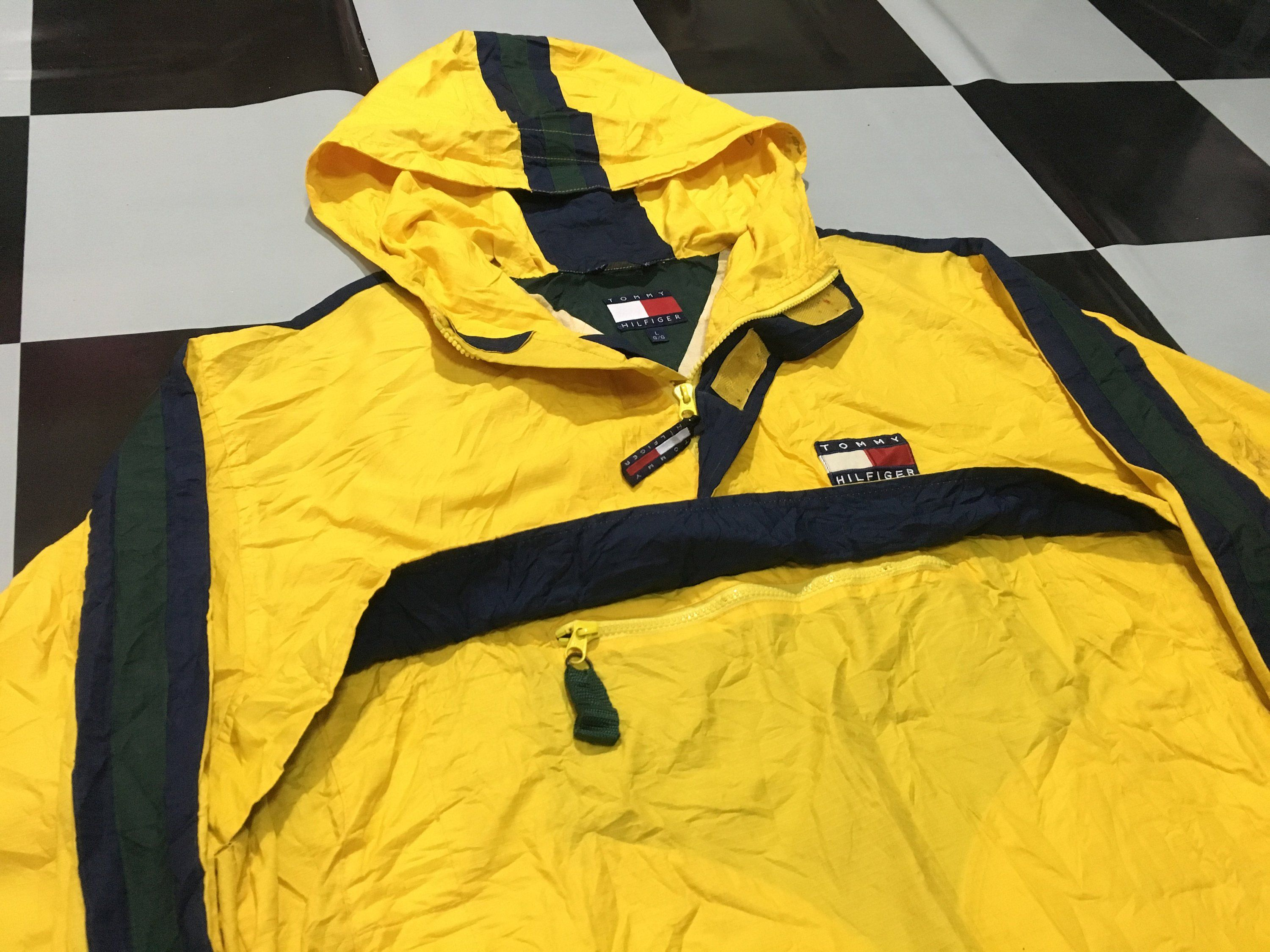 6c9dcb2d0adb Vintage Tommy hilfiger jacket windbreaker pullover anorak jacket flag logo  reflective two tone Yellow Black Size L Excellent condition by  AlivevintageShop ...