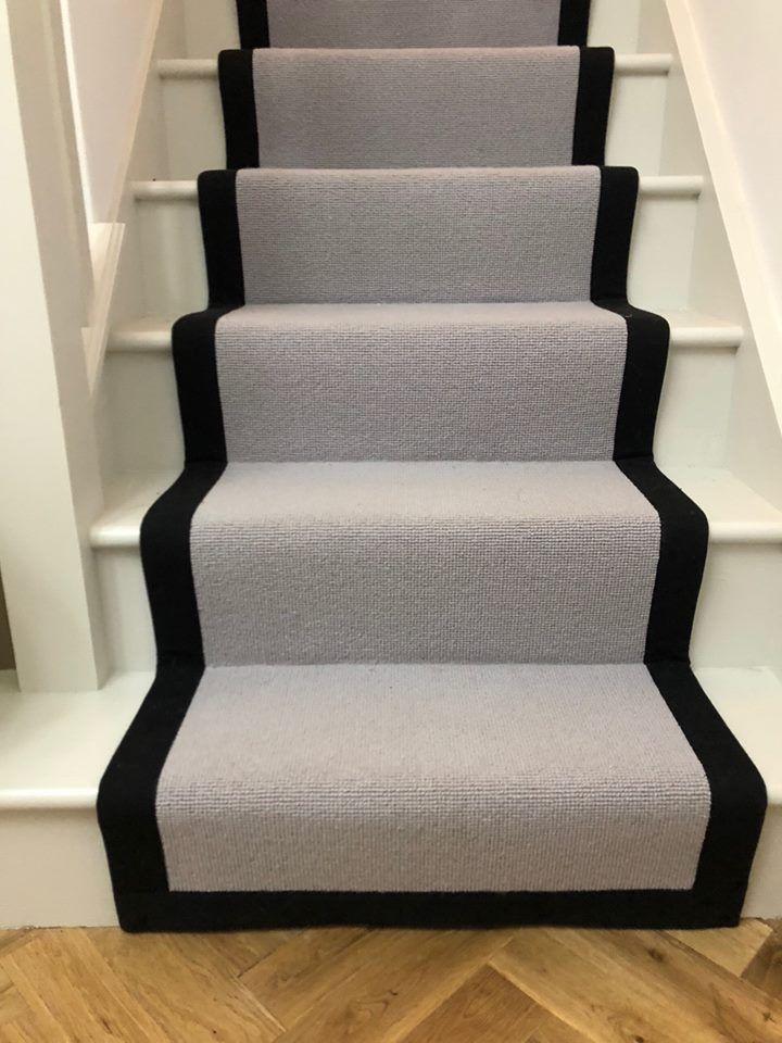 Black cotton edging on a grey stair runner