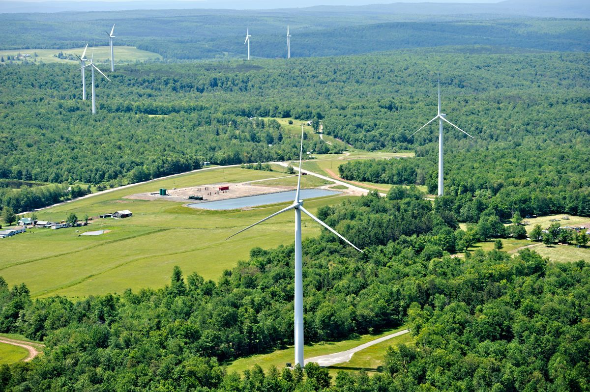 Windmill farm in bradford county pa showing a gas drillng