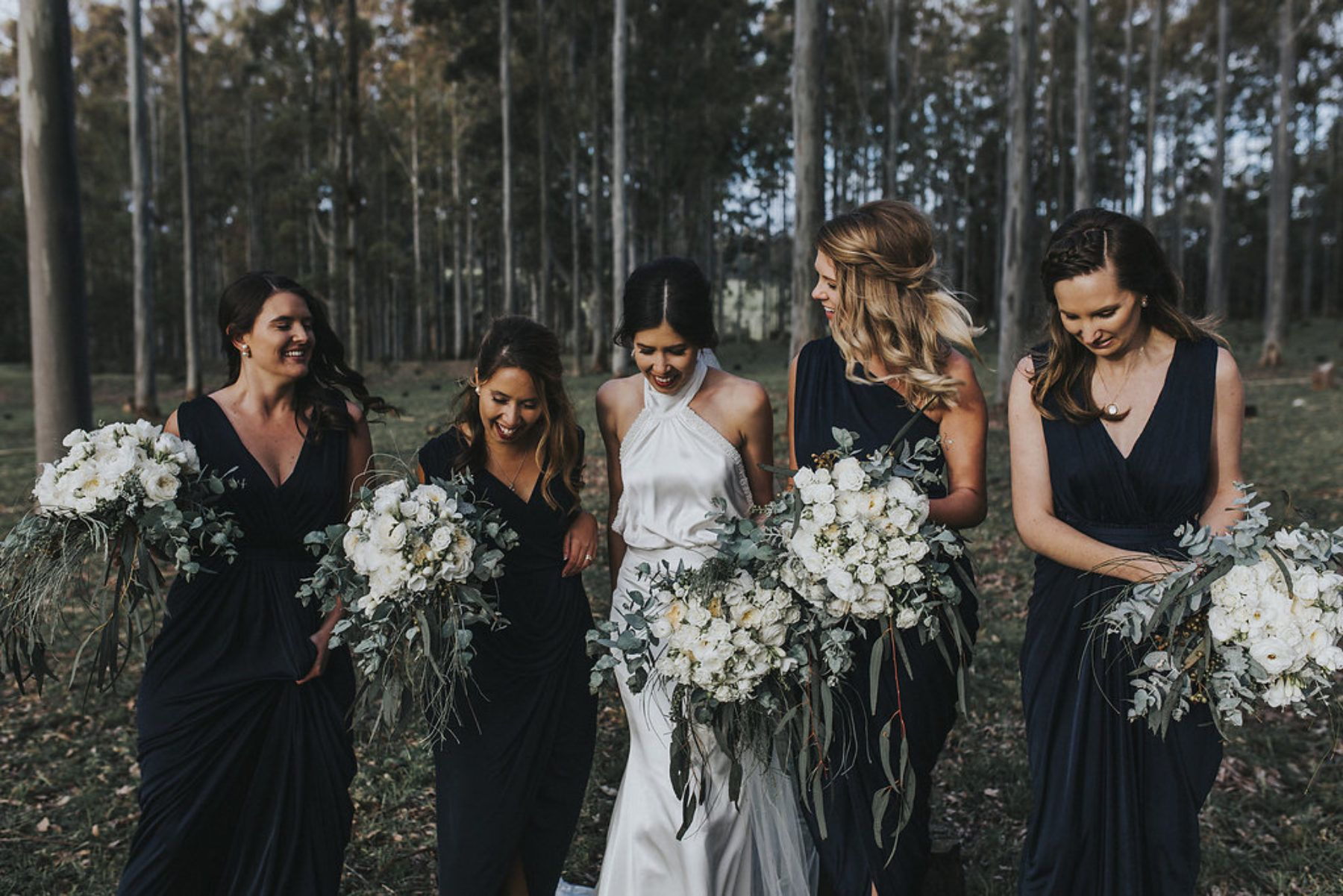 Navy bridesmaids with green and white bouquets weddings colors