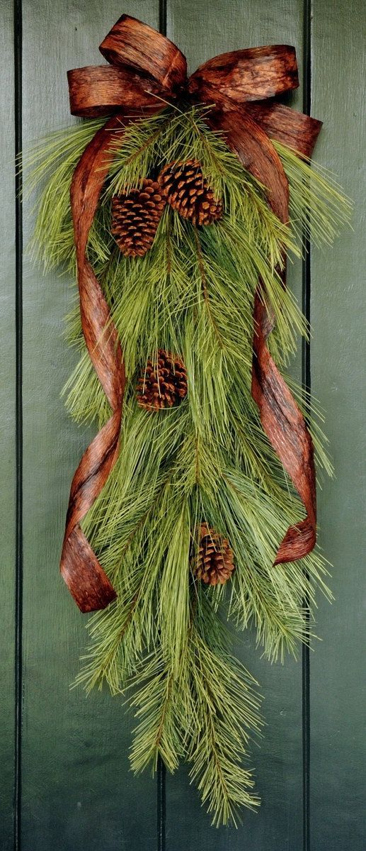 Evergreens....next year Costco roping made into swags!!!!!  Love the brown ribbon bow.