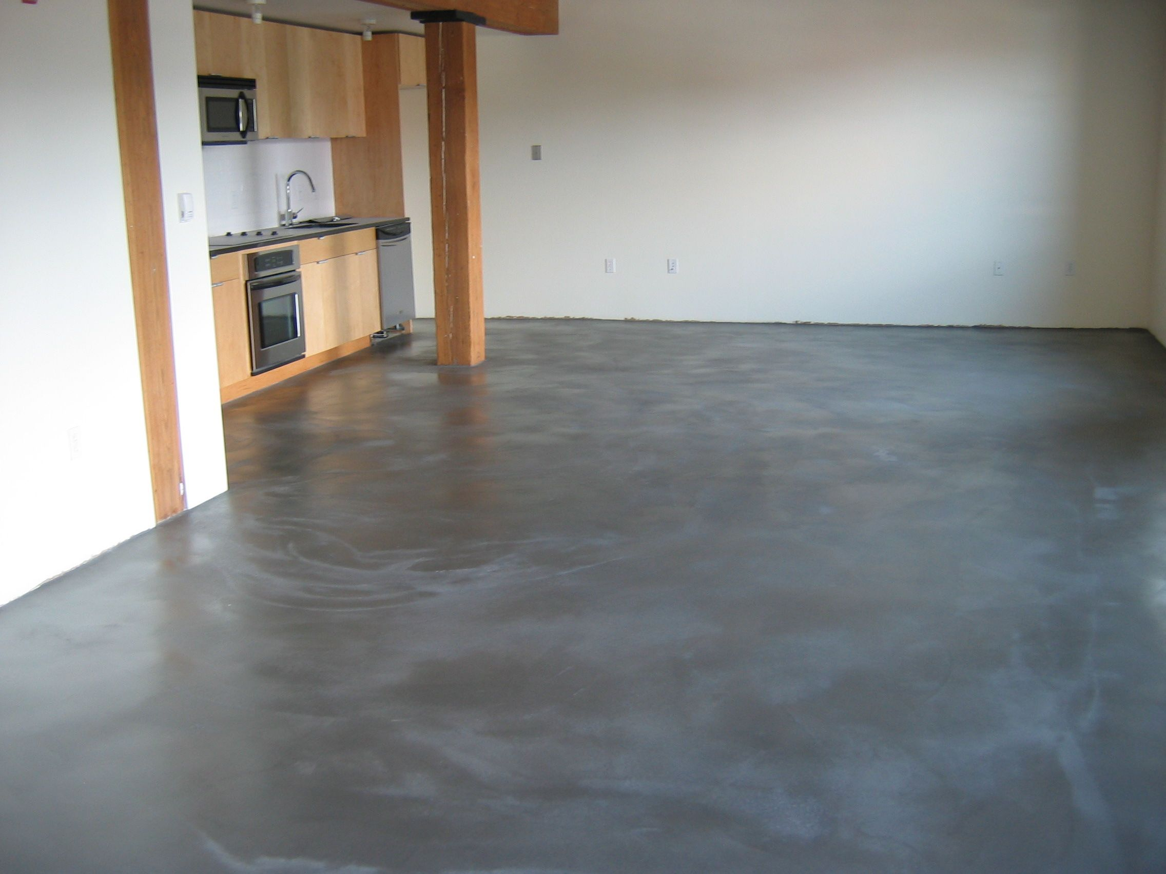Poured concrete floors concrete polishing concrete for Stained polished concrete floor