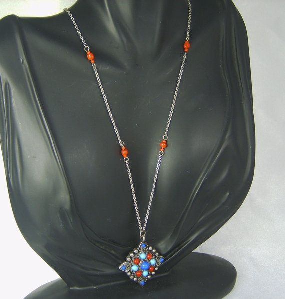 30% off #sale until 11/23/15 A beautiful beaded #necklace in #silver tone metal.  This necklace is quite unique having a silver tone metal base which forms the chain and base for the pendant.  The chain ... #vintage #jewelry #judysgems2 #teamlove #blue #turquoise #red #gift #diamond
