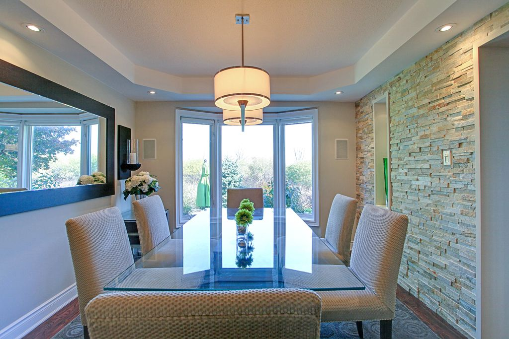 Beautiful Open Concept Dining Room With Slate Stone Accent Wall