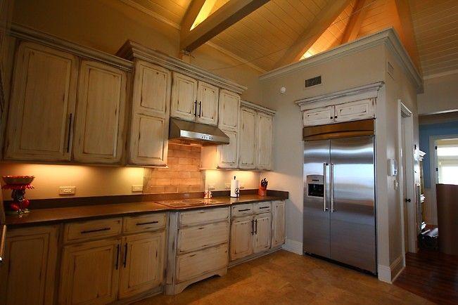 interesting shabby chic kitchen cabinet   Distressed white wood kitchen cabinets in this shabby chic ...