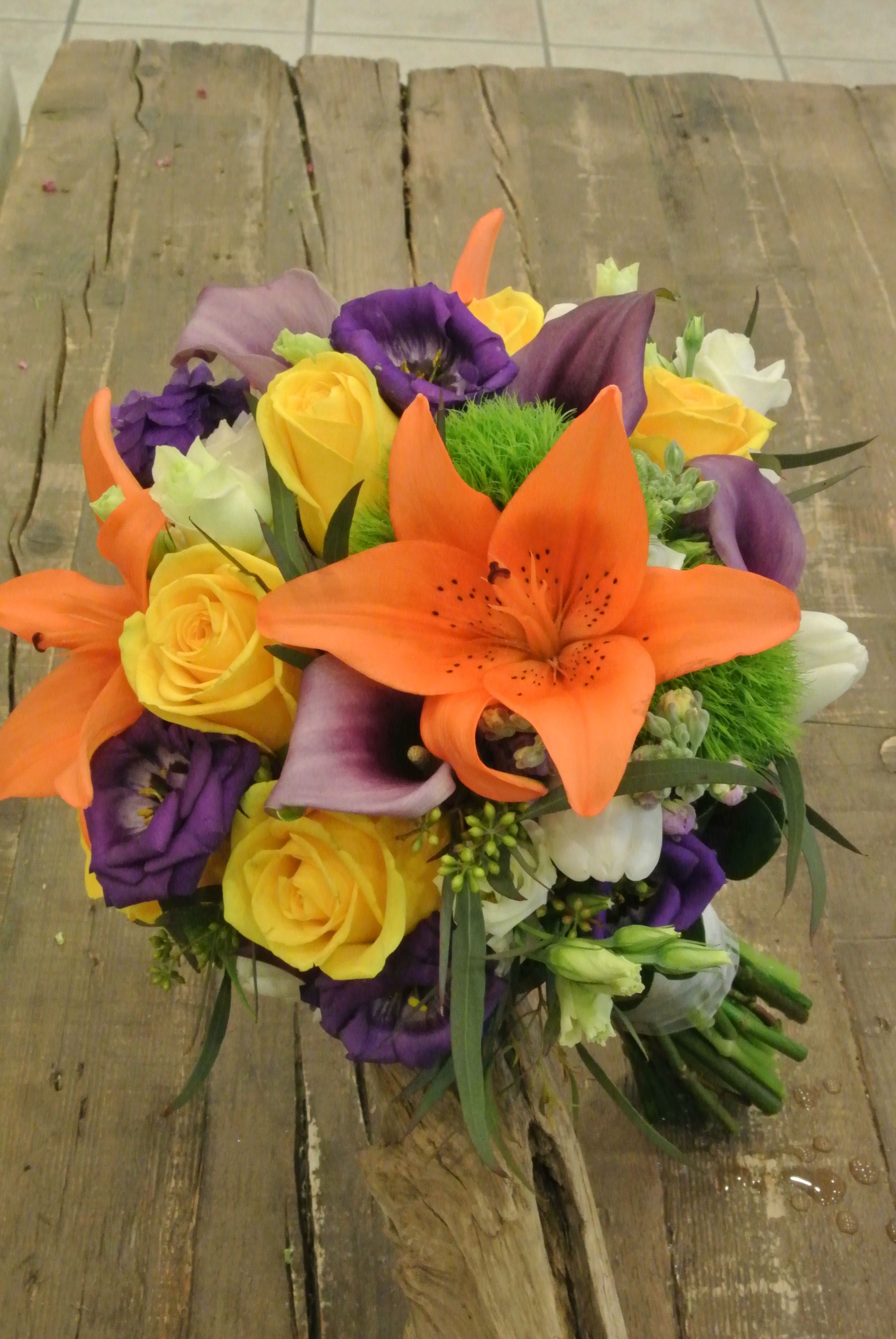 Bright bridal bouquet with orange asiatic lilies, yellow
