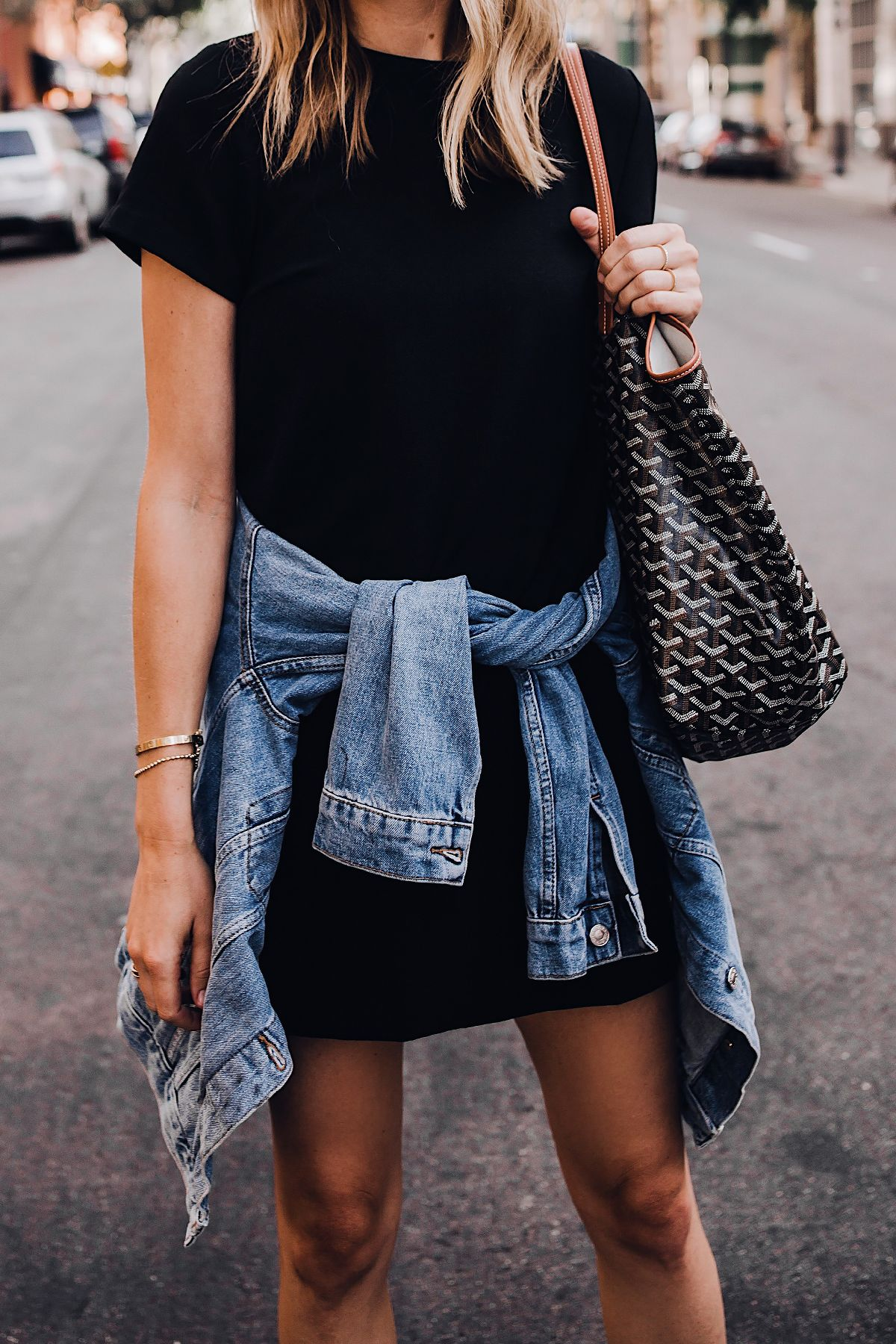 Blonde Woman Wearing Fashion Jackson Short Sleeve Black Dress Denim Jacket Goyard Tote Fashion Jackson S Black Dress Outfit Casual Casual Style Outfits Fashion [ 1800 x 1200 Pixel ]