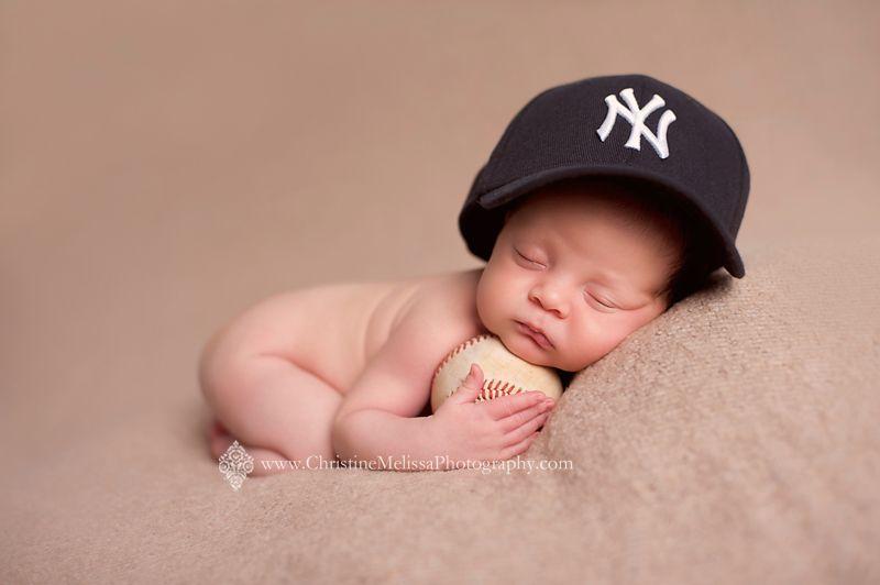 Yankees baby newborn with baseball newborn with baseball hat long island newborn photographer