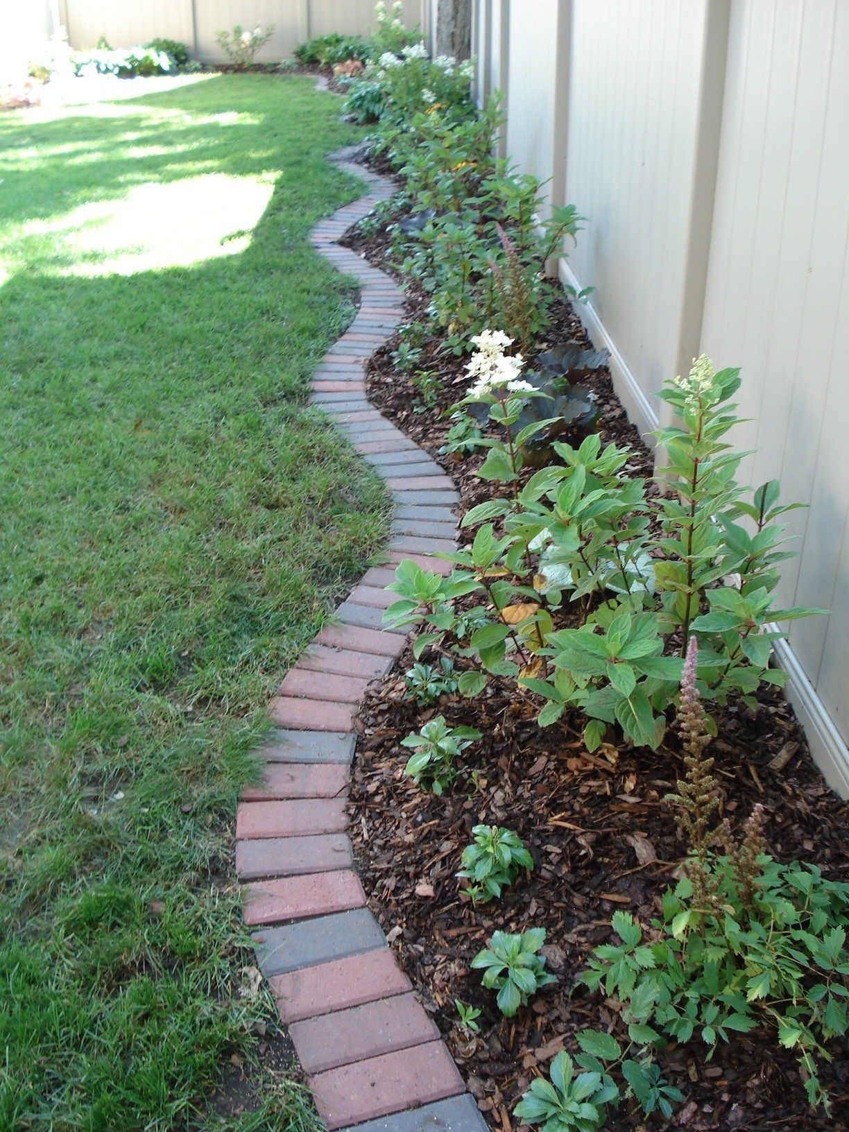 Brick edging traditional 4 x 8 clay bricks create an for Garden trim