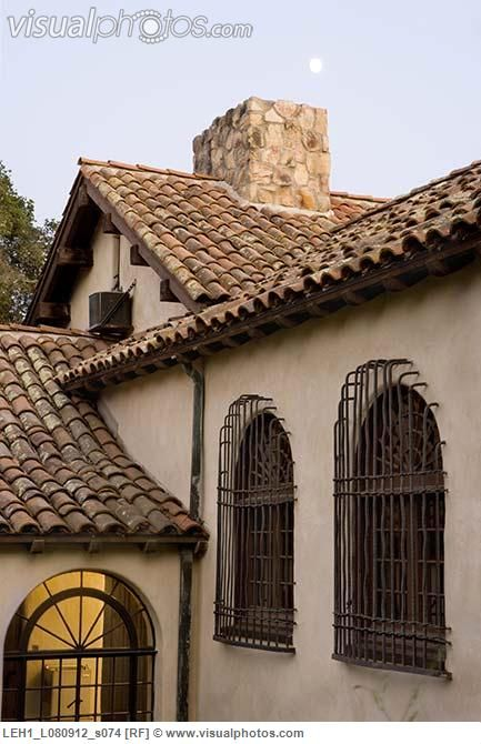 clay roof tiles windows with wrought