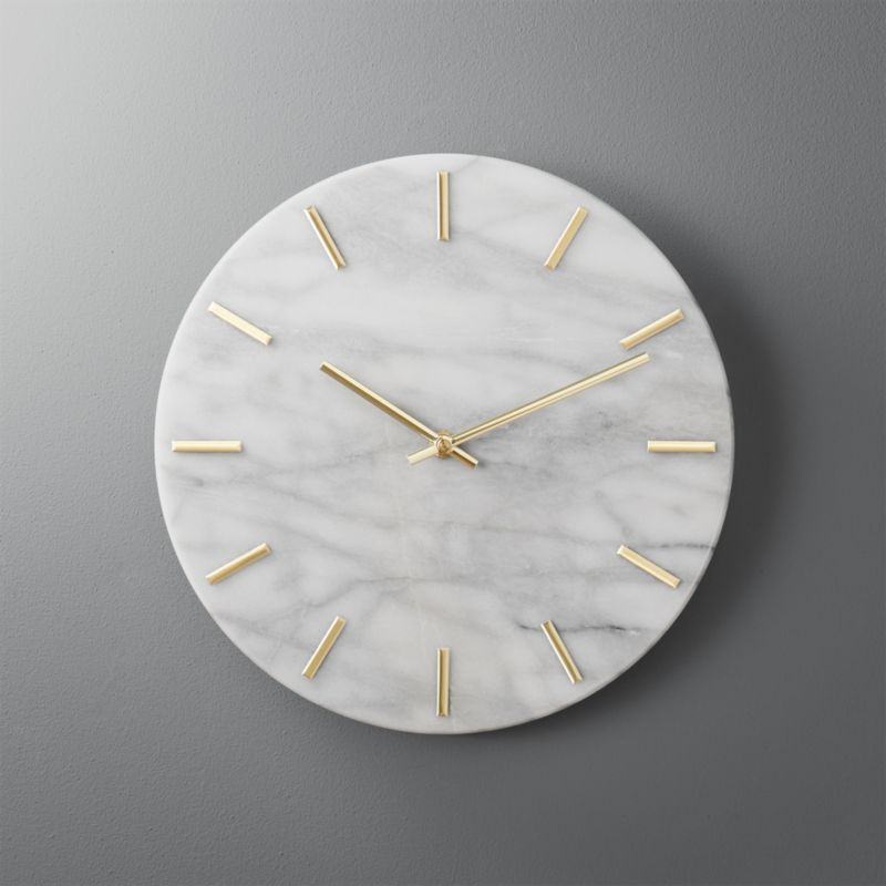 Carlo Marble and Brass Wall Clock + Reviews   CB2 is part of Marble wall - Shop Carlo Marble and Brass Wall Clock    Shiny brass hands tell time on smooth, white marble   Simple, clean design indicates the hour with minimalist dashes instead of numbers   Elevates the entry or goes glam on a gallery wall