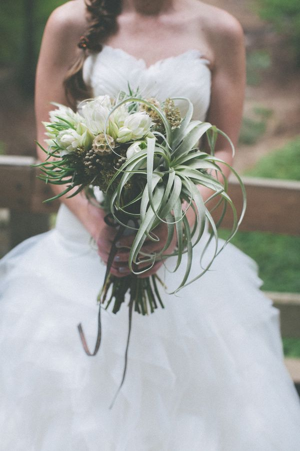air plant bouquet, photo by Evynn LeValley http://ruffledblog.com/henry-miller-library-wedding #flowers #bouquets